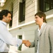 Two businessmen shaking hands while standing outdoors — Stockfoto #21930261