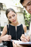 Two business meeting outdoors in a tree ligned street. — Stock Photo