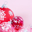 Red and pink Christmas barballs ornaments with snow flake details and glitter detail. — Stockfoto