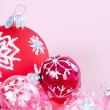 Red and pink Christmas barballs ornaments with snow flake details and glitter detail. — Stock Photo