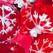 Red and pink Christmas barballs ornaments with snow flake details and glitter detail. - Stock Photo