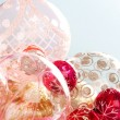 Various Christmas barballs ornaments in different sizes and colors - Stock Photo
