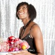 Young black woman holding a dish full of christmas barballs — Stok fotoğraf