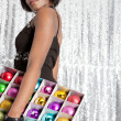 Young balck woman holding a box with different color christmass balls - Stock Photo
