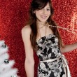 Portrait of a young attractive woman with a small christmas tree — ストック写真
