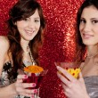 Two young women toasting and drinking cocktails — Stock Photo #22106989