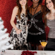 Three women friends smiling at a christmas party — Lizenzfreies Foto