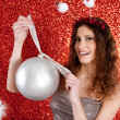 Attractive young woman holding an over sized Christmas bar ball — Stok fotoğraf