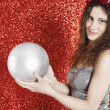 Attractive girl holding a large Christmas ball — Stock Photo