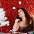 Attractive young woman decorating a white Christmas tree - Stockfoto