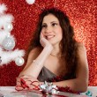 Attractive young woman decorating a white Christmas tree — Stok fotoğraf