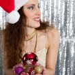 Young attractive woman holding a choice of Christmas tree bar balls — Stok fotoğraf