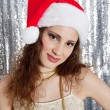 Attractive young woman wearing a Santa hat — Stock Photo #22107231