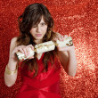 Young woman pulling a Christmas cracker — Stok fotoğraf