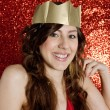 Portrait of an attractive young woman wearing a gold paper crown — ストック写真
