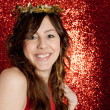Portrait of an attractive young woman wearing a gold stars crown — Stockfoto
