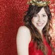 Young attractive woman wearing a gold tinsel tiara — Stockfoto