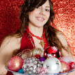 Young woman holding a dish full of Christmas bar balls — Stock Photo