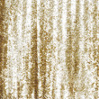 Stock Photo: Full frame gold sequins curtain background texture.