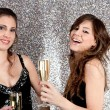 Two young women toasting with champagne glasses — Стоковая фотография