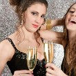 Two young women toasting with champagne at a party — Stock Photo #22107629