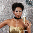 Attractive young black woman holding a champagne glass — Foto de Stock