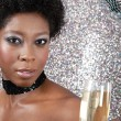 Attractive black woman holding an champagne glass — Stock Photo #22107663