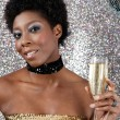 Attractive black woman holding an champagne glass — Stock Photo