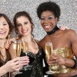 Two young women toasting with champagne at a party — ストック写真