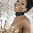 Attractive black girl holding a glass of champagne — Stock Photo