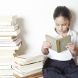 Young school girl reading a book — Stock Photo #22108333