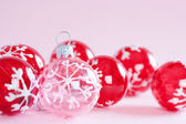 Red and pink Christmas tree ornaments barballs framed — Stock Photo