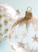 Glass and glitter Christmas tree barball ornaments with silver stars and spots — Stock Photo
