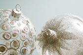 Glass and glitter Christmas tree barballs ornaments with silver stars and spots — Stock Photo