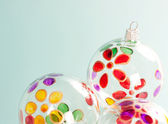 Three christmas barballs decorated with colorful flower petals — Stock Photo