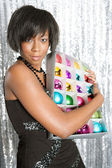 Young balck woman hugging a box with different color christmass balls — Stock Photo