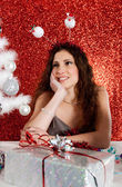 Attractive young woman decorating a white Christmas tree — Stock fotografie