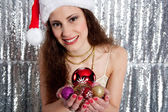Young attractive woman holding a choice of Christmas tree bar balls — Stock Photo