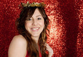 Portrait of an attractive young woman wearing a gold stars crown — Stock Photo