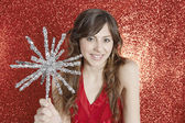 Attractive young woman holding a Christmas star — Stock Photo