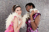 Two young women having a party and dancing — Stock Photo