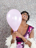 Attractive young black woman holding pink balloon — Stok fotoğraf