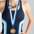 Middle section of an olympic swimmer's body wearing a gold medal — Stock Photo