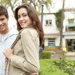 Portrait of a young couple on vacations in a picturesque town square. — Stock Photo