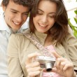Young couple looking at their holiday pictures on a digital photo camera — Stock Photo