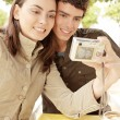Portrait of a young couple on vacations, taking pictures of themselves — Stock Photo