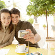 Young couple taking a picture of themselves  — Stock Photo