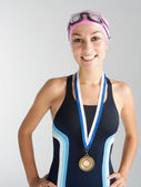 Young olympic swimmer proundly wearing a gold medal — Stock Photo