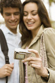 Portrait of a young tourist couple taking a picture of themselves on vacations. — Stock Photo