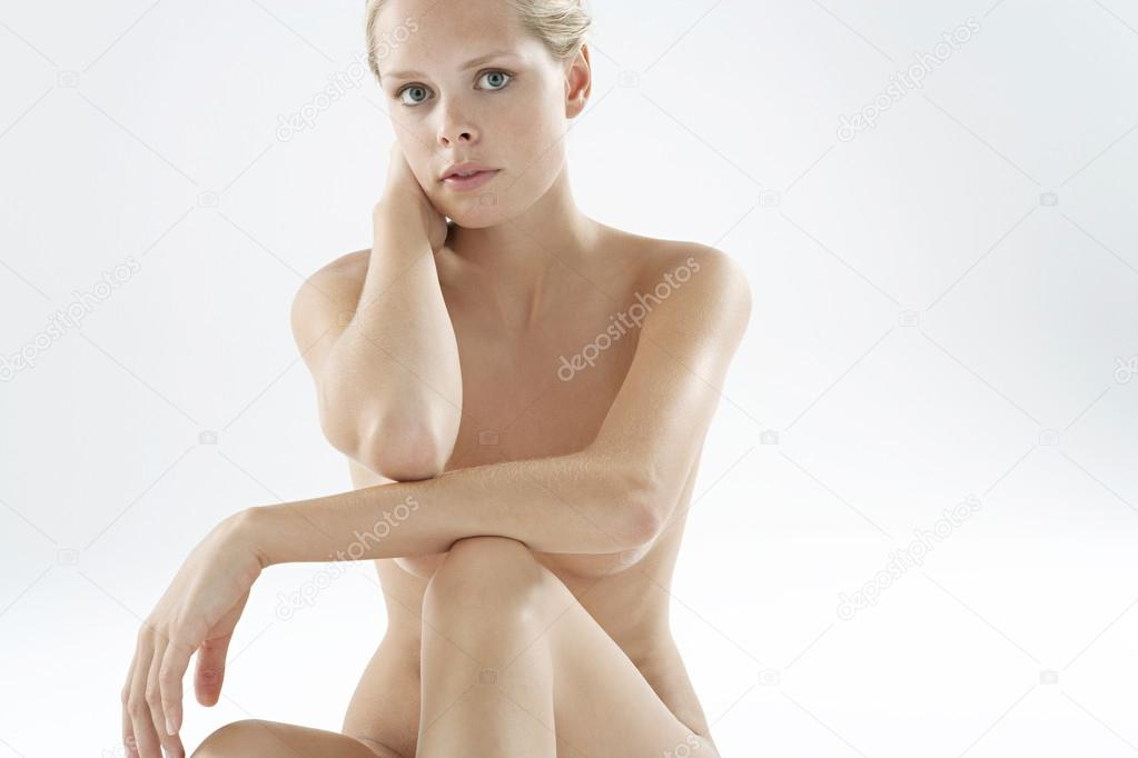 Young Nude Woman Sitting Down Stock Image